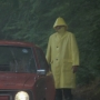 that man in his yellow raincoat